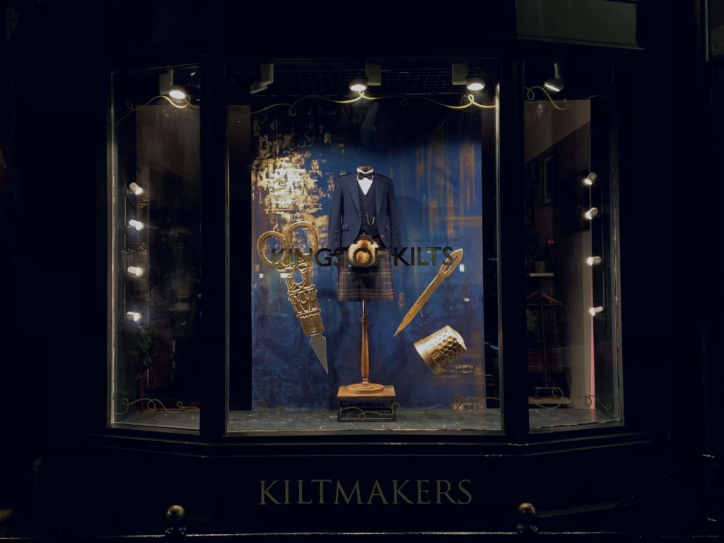 The window display of kiltmakers MacGregor and MacDuff in Glasgow City Centre. RCS Production Arts and Design student Lu Herbert created the display which features a Highland outfit with large props on either side including scissors and a sewing needle