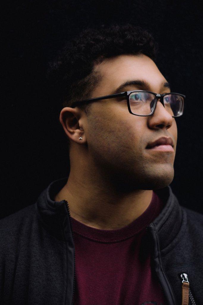 Composer Evan Bailey looking off camera.