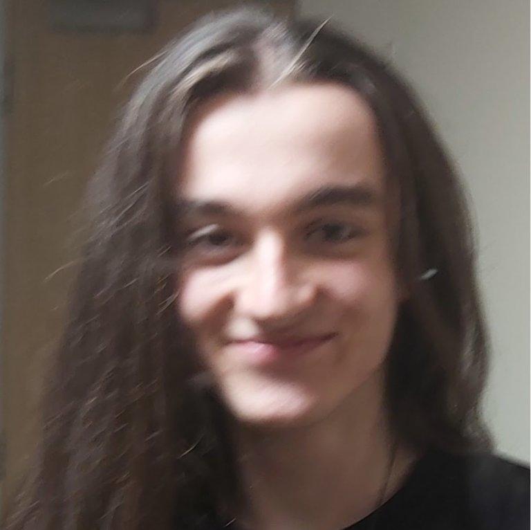 Composer Joe Strike smiling into camera.