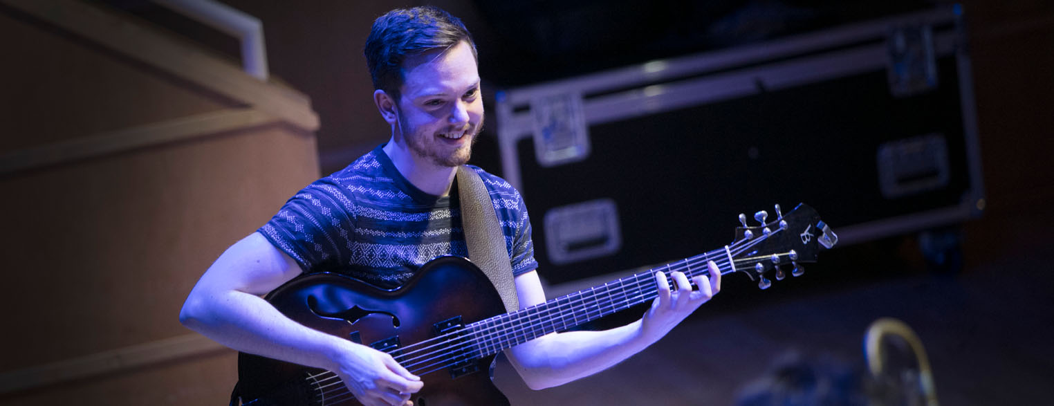 Jazz student playing guitar
