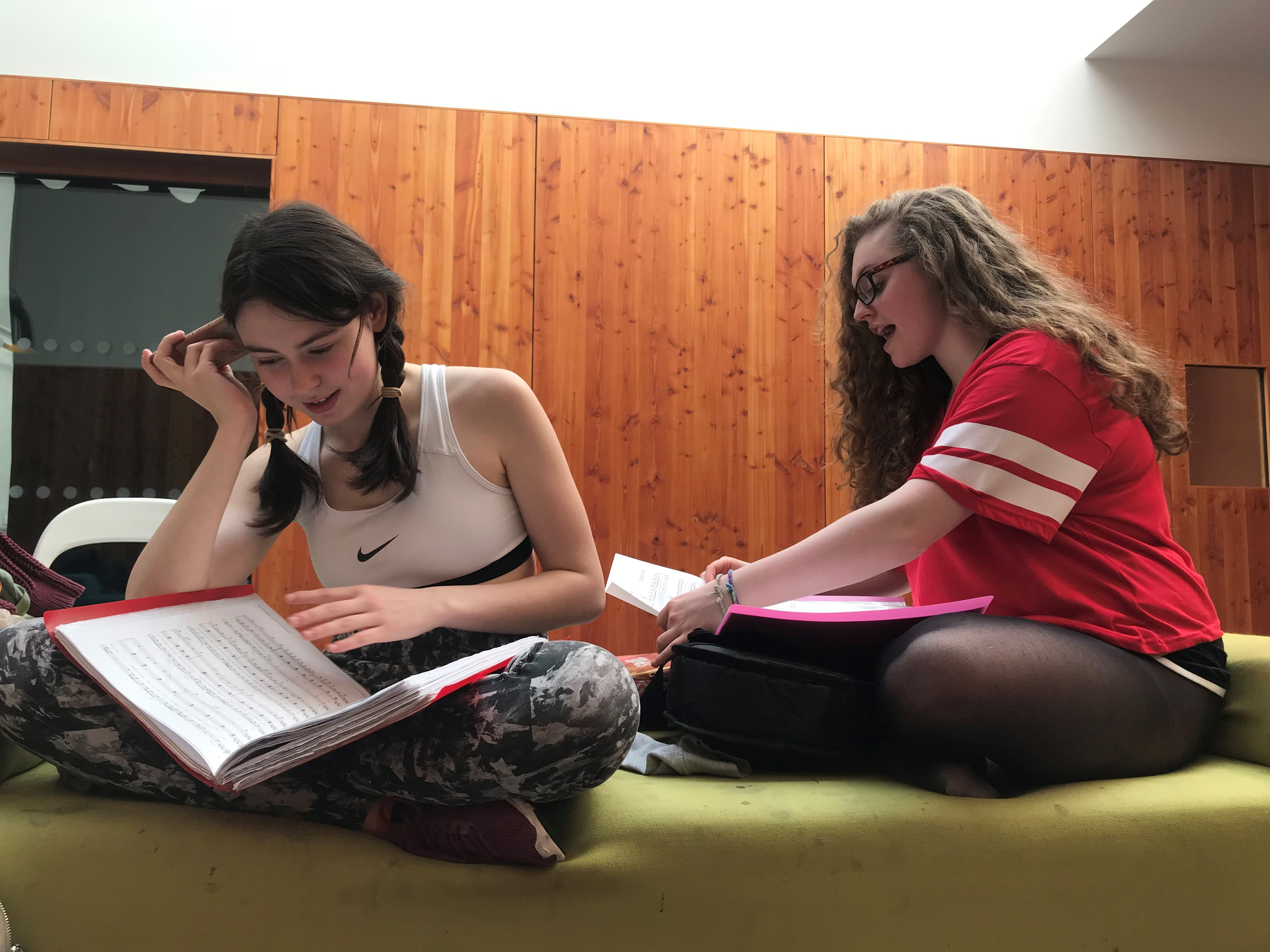 Two students learning lines from a play