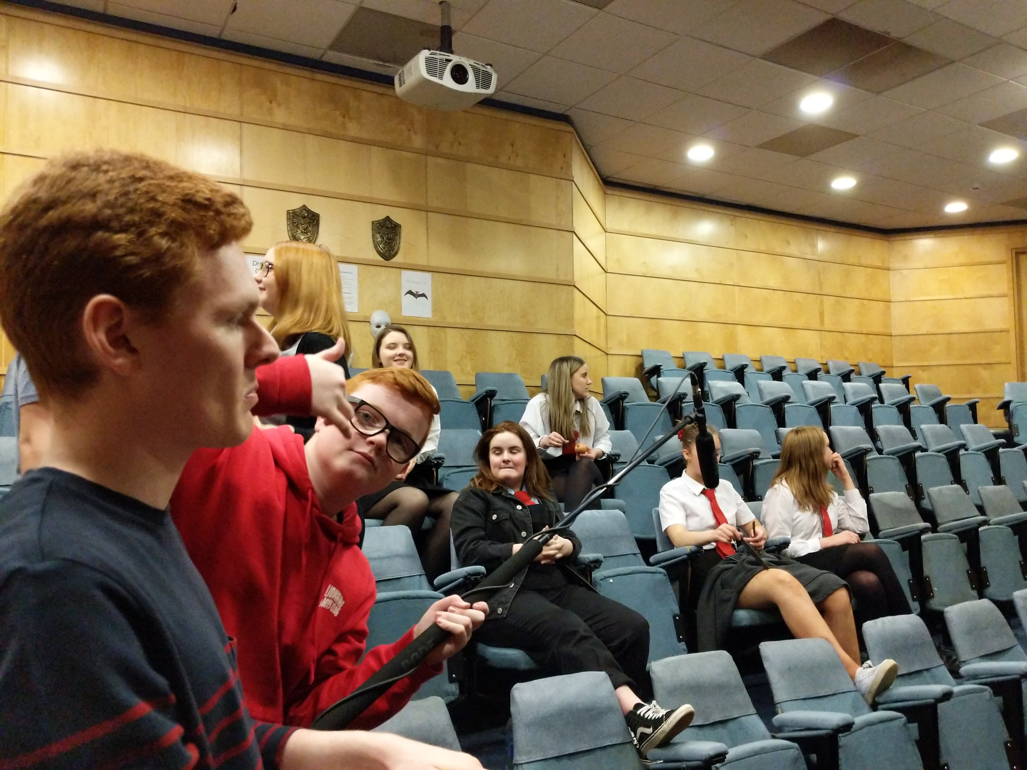 A picture of the Fyfe Lecture room with Abigail's friend Colby holding a boom pole