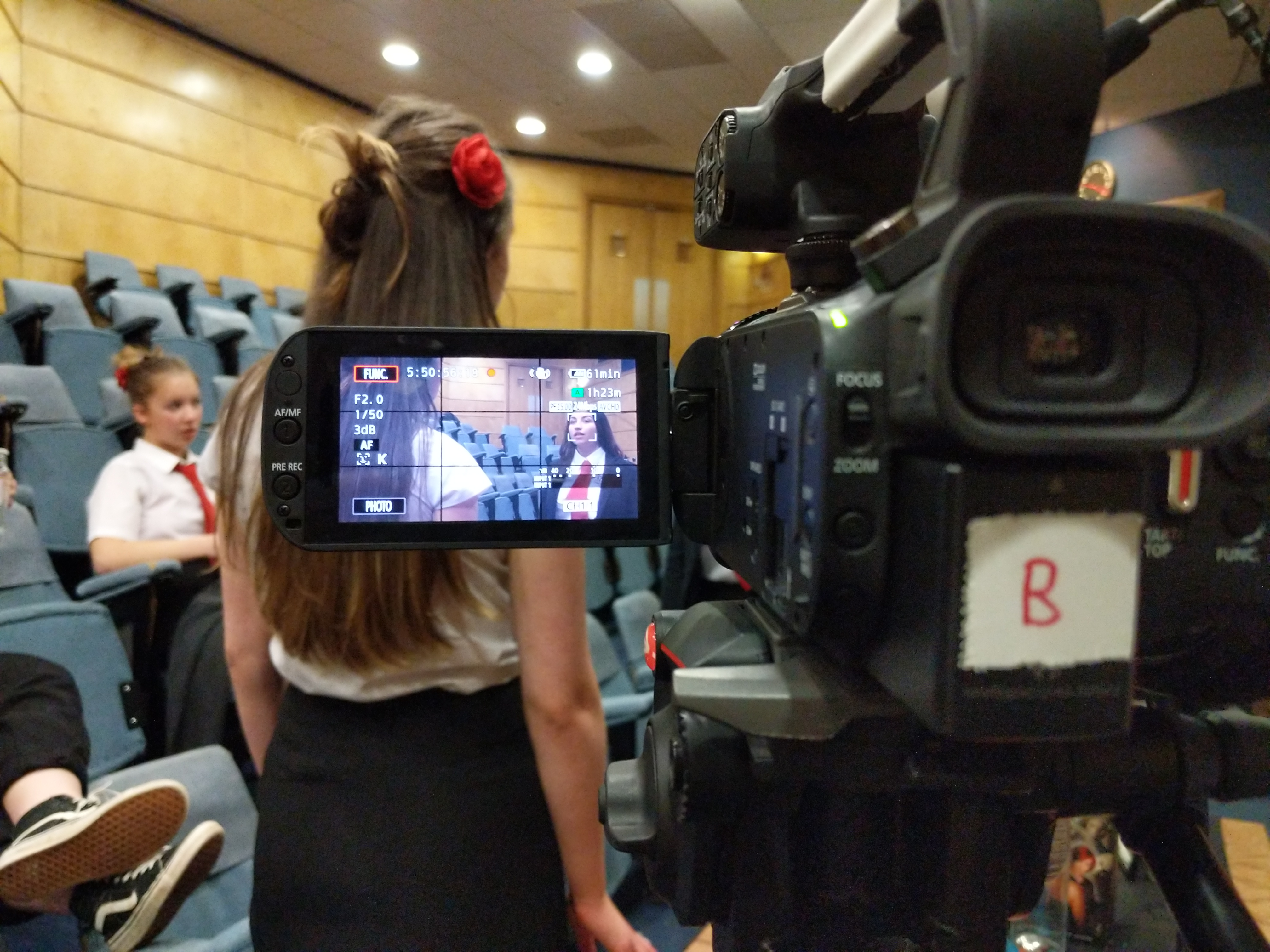 Camera filming two students acting in the Fyfe lecture room