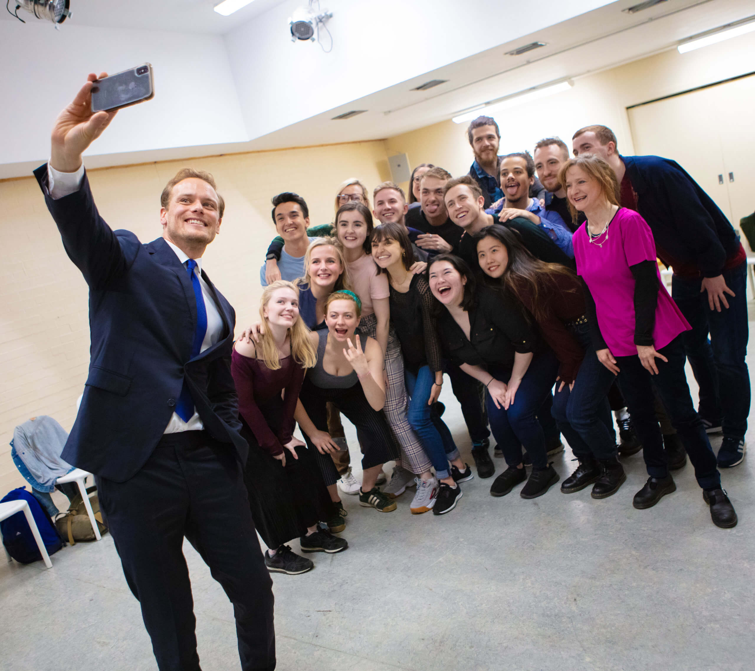 Acting graduate and Outlander star Sam Heughan takes a selfie with BA Acting students and staff