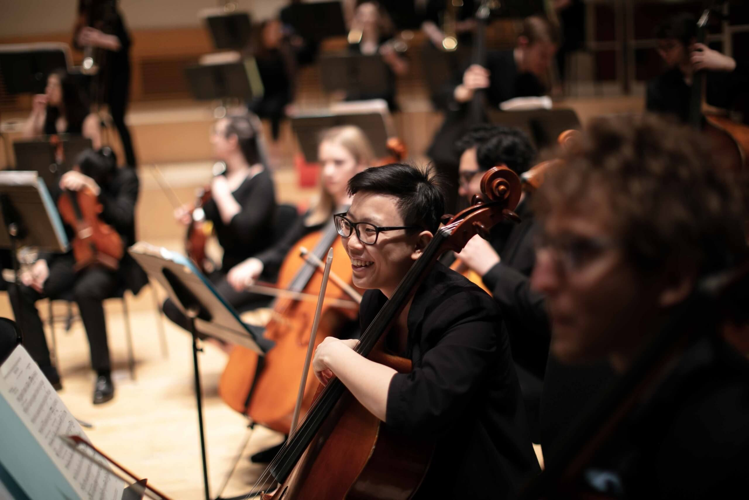 A musician smiles during an RCS symphony orchestra concert
