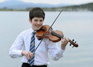 Picture by SANDY McCOOK 10th October '15 Royal National Mod 2015 Oban Lachlan Kennedy of Edinburgh but whose family are from Lewis and Inverness with his Gold Medal for Fiddle music in the under thirteen age group.