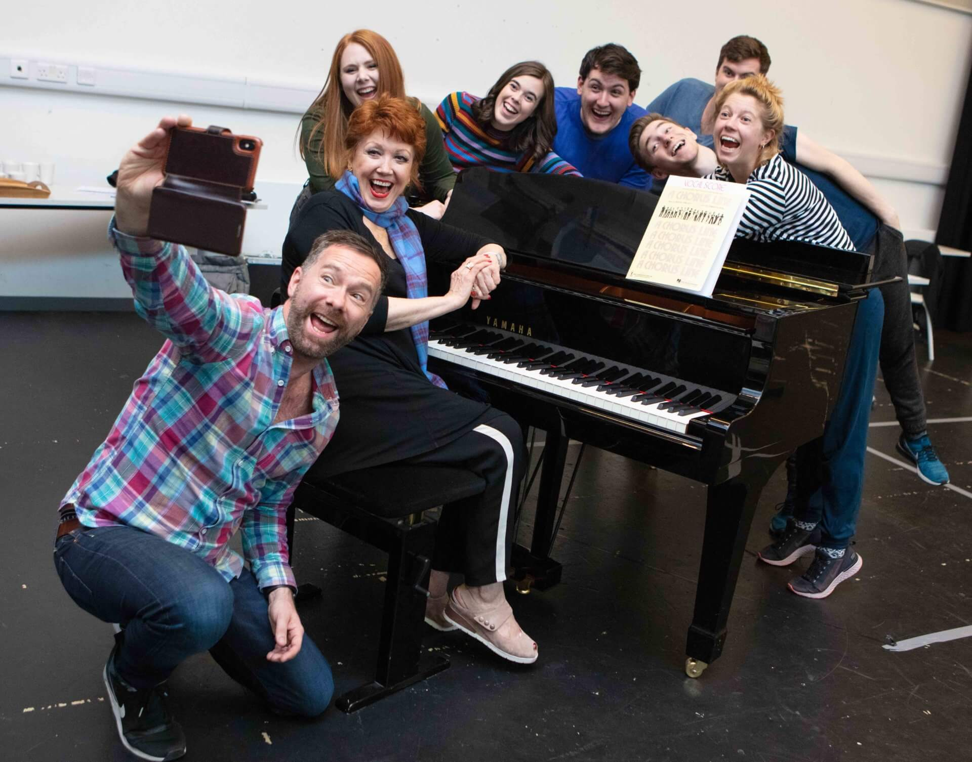 Broadway star Donna McKechnie at a piano with Musical Theatre students of the Royal Conservatoire of Scotland