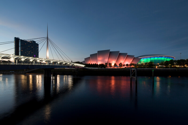 Twilight scene of Clyde waterfront with SECC lit up