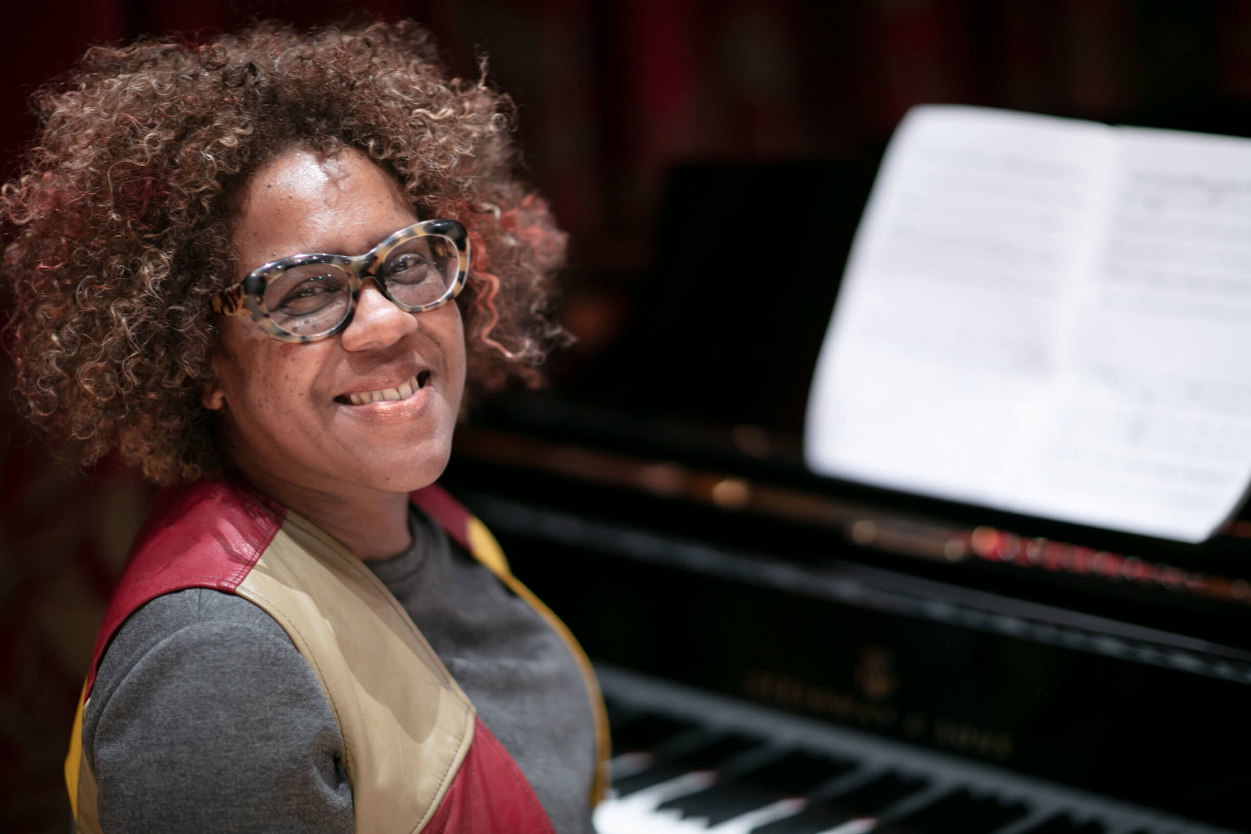 Errollyn Wallen CBE, Visiting Professor in Composition at the Royal Conservatoire of Scotland. Errollyn is pictured at a piano in the Stevenson Hall concert venue