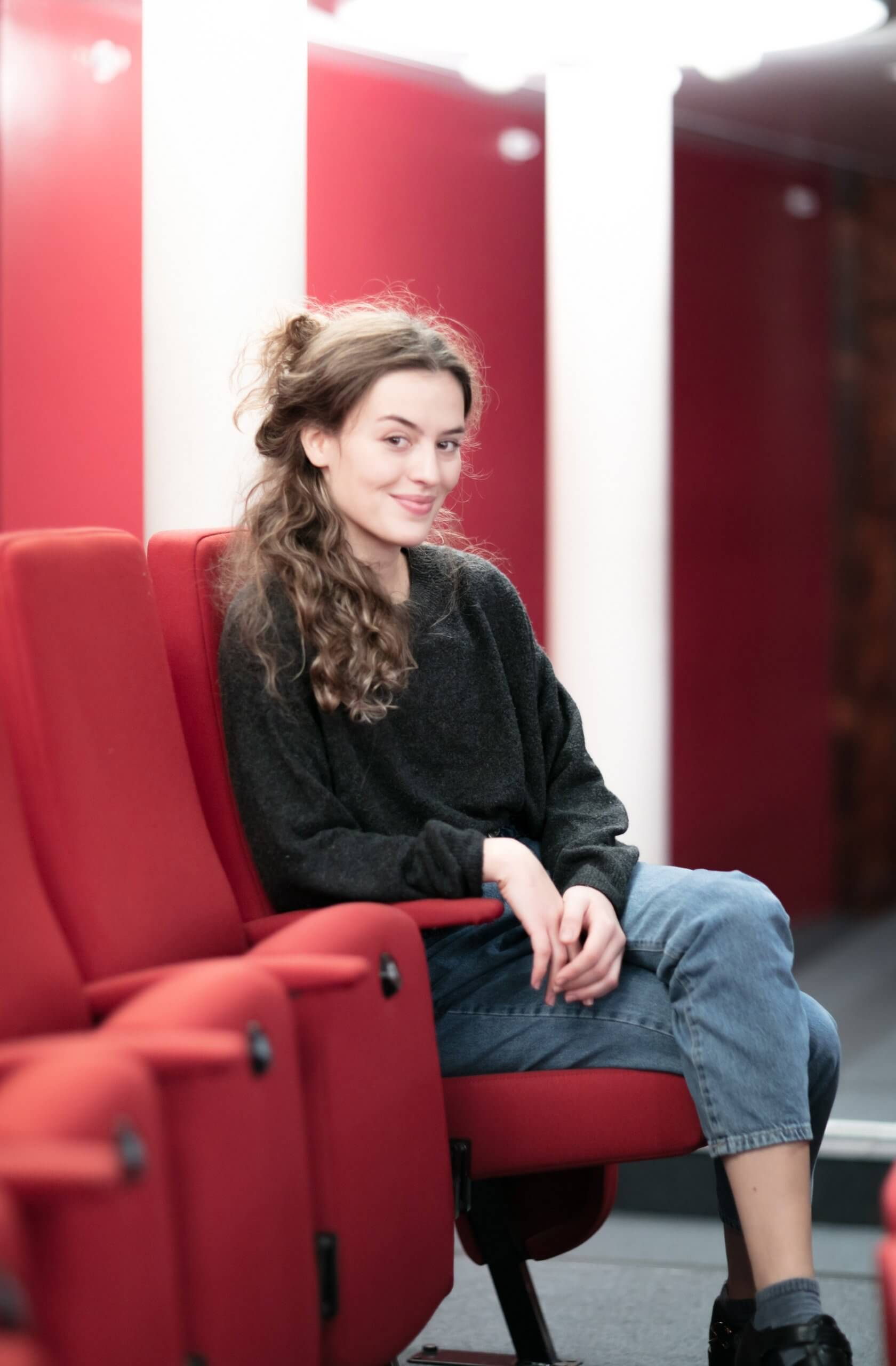 RCS acting student Sylvie Marinkovic sits in a red seat in the stalls in the New Athenaeum Theatre in RCS. Sylvie is one of ten actors worldwide chosen for Warner Bros TV's Class of 2020 initiative.