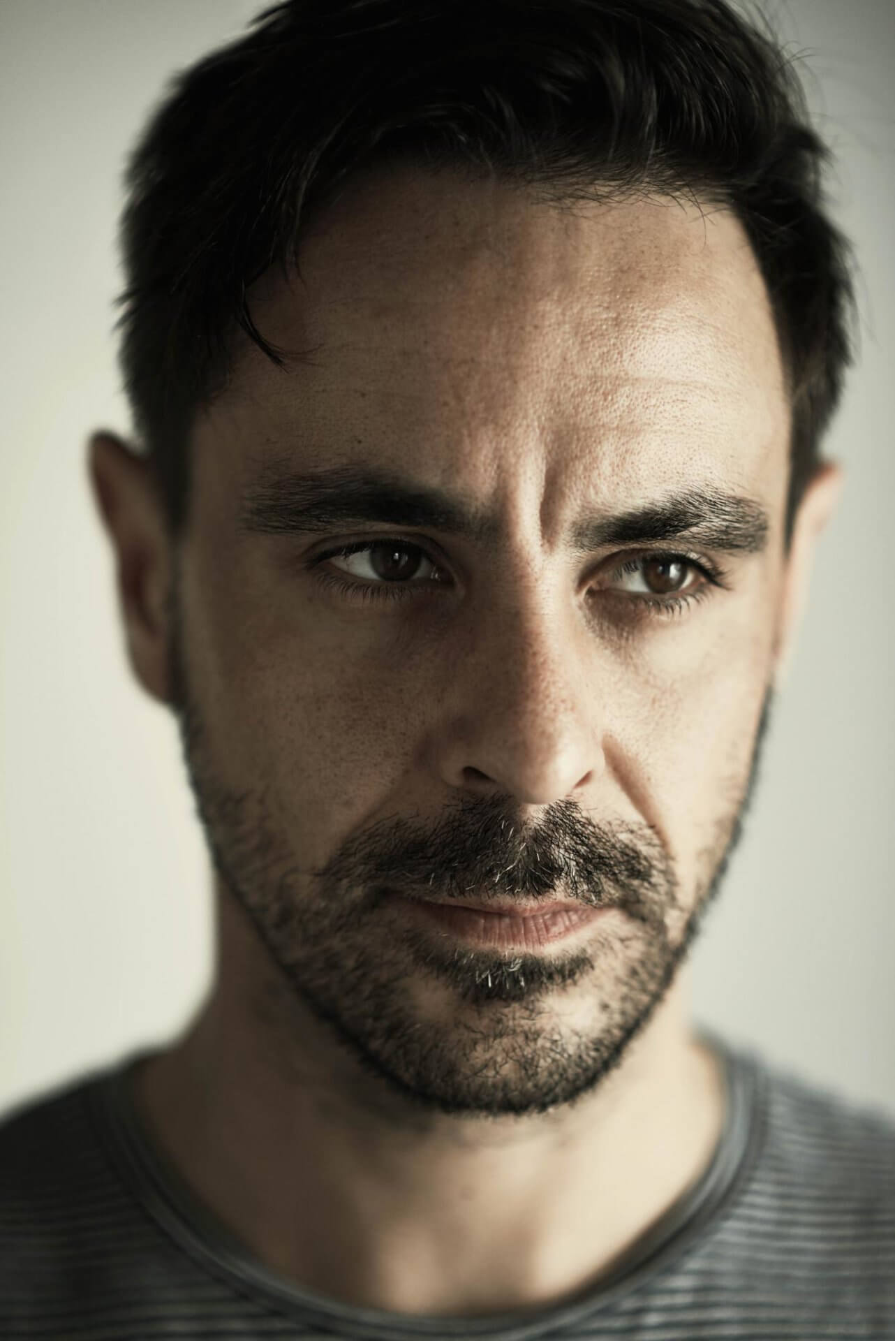 Actor Emun Elliott looks off to the side in this head shot